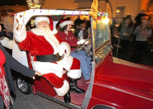 Santa Claus parades down Forest Avenue en route to his cabin to meet families for Hospitality Night in downtown Laguna Beach.