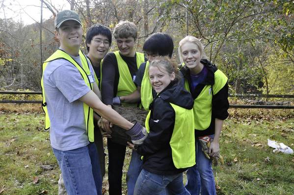 Rouse Scholars, from left, Ethan Wasil, Lemuel Sun, Zechariah Bennett, Maximllian Minchang, Ekaterina Dibenedetto and Annalee Eash, help plant trees with the Friends of Patapsco as part of a service learning project.