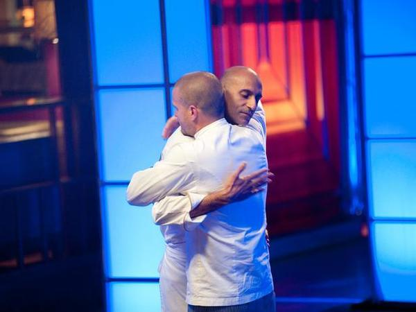 "Jehangir Mehta hugs Nate Appleman after being eliminated from ""Next Iron Chef."""