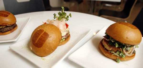 Customers can enjoy different burgers such as the Le Cordon Bleu Burger and the Ahi Tuna Burger at Umami Burger in Pasadena.