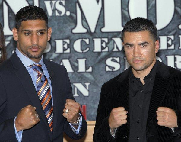 Amir Khan, left, will face Carlos Molina on Saturday at the Sports Arena.