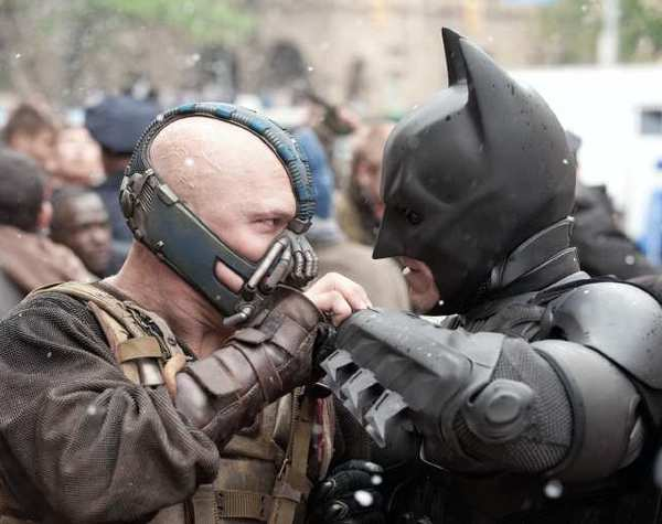 "Tom Hardy as Bane and Christian Bale as Batman in the action thriller ""The Dark Knight Rises,"" a Warner Bros. Pictures release."