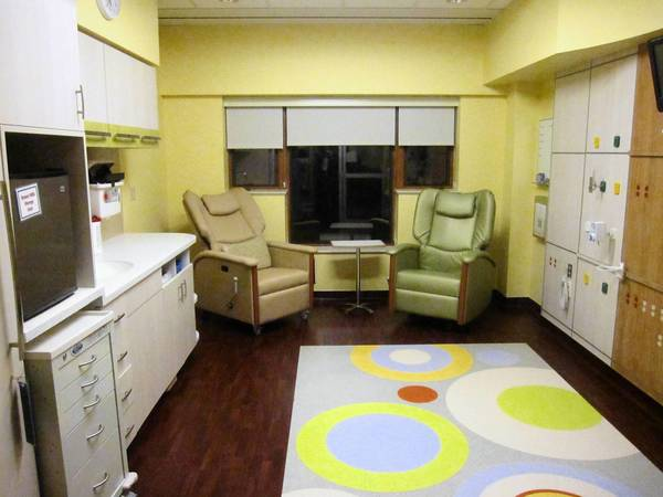 The new private rooms in Edward Hospital's Newborn Intensive Care Unit are each 200 square feet and include two oversized chairs, a refrigerator for breast milk, a computer, locker, supply cart and report board. (cq)