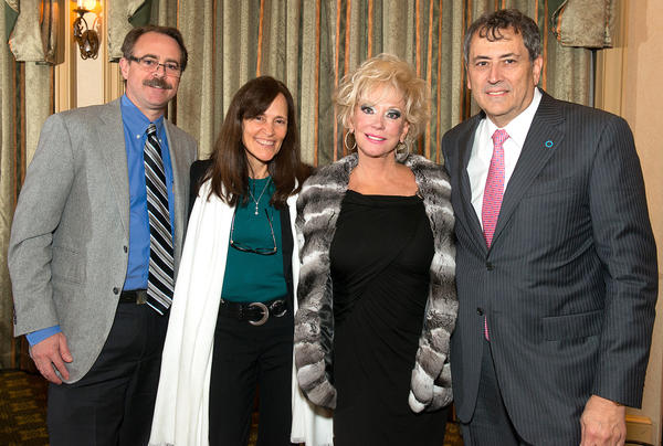 "Dr. John Newcomber, left, Dr. Norma Sue Kenyon, Kathy Simkins and Jay Skyler at the Diabetes Research Institute's ""Love and Hope Preview Party,"" which took place Nov. 17 at the Diplomat Country Club and raised nearly $400,000."