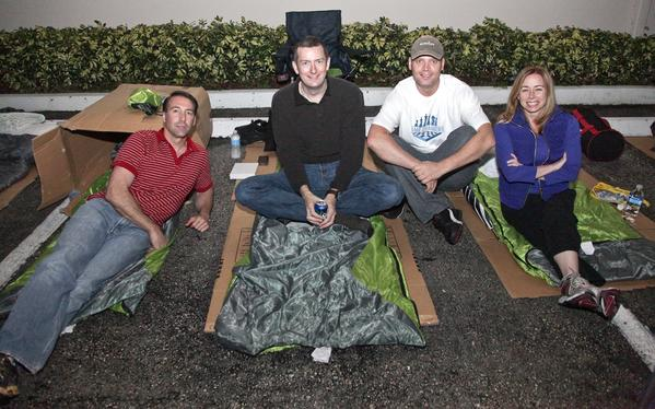 "Sean Fitzpatrick, left, Andrew Wilson, Jan Vrins and Christina Elgarresta at the Covenant House's ""Sleep Out to Support Homeless Youth,"" which took place Nov. 15 behind the shelter and raised more than $65,000."