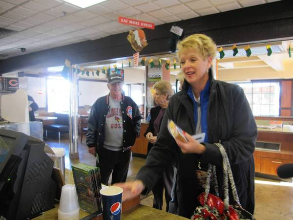 Orland Park resident Cathy Burns was the first customer to receive a Twinkie from Baby's Cheesesteak & Lemonade in Orland Park Dec. 5.