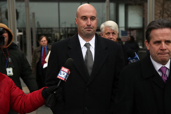 Mayor Richard M. Daley's nephew Richard Vanecko, center, leaves the Leighton Criminal Court Building on Monday with his lawyer Marc Martin, right, after his arraignment on the charge of involuntary manslaughter for the death of David Koschman in the Rush Street nightlife district in 2004. Vanecko pleaded not guilty.