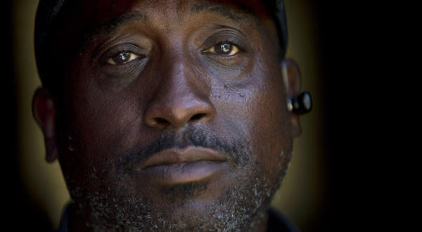 Homeless veteran Jerome Belton poses for a portrait at a shelter in San Diego. Homelessness among veterans and in general is down nationwide.