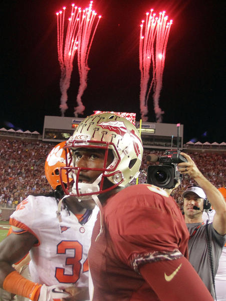 FSU quarterback E.J. Manuel celebrates on the field after winning the Clemson at Florida State University football game at Doak Campbell Stadium in Tallahassee on Saturday, September 22, 2012. FSU won the game 49-37.