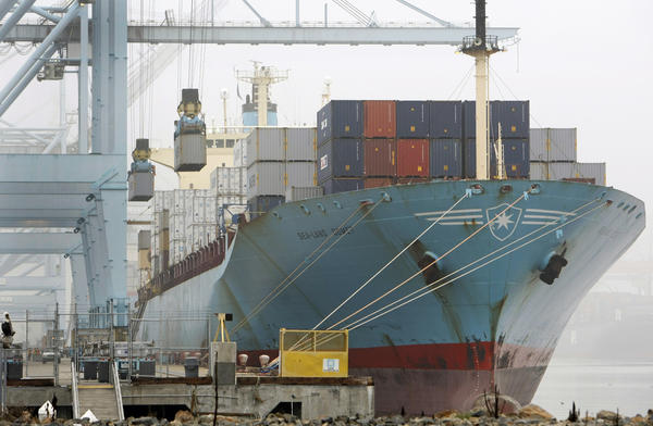 A report released by the National Retail Federation projects that December cargo volume will be up nearly 4% from December 2011. Above, a cargo ship is unloaded at the Port of Los Angeles after an eight-day strike ended.