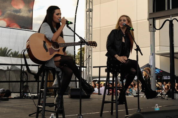 Megan & Liz perform onstage at the Y100's Pre-Show at Jingle Ball Village on the plaza at the BB&T Center on December 8,2012 in Miami.
