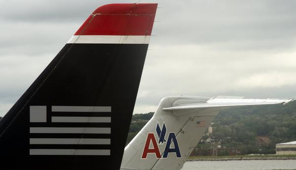 "According to , ""US Airways and AMR are negotiating toward a potential merger agreement that the smaller rival hopes could come as soon as January."""