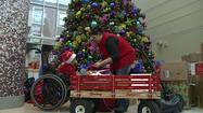 A former Riley patient is bringing Christmas cheer to those still there during the holidays.