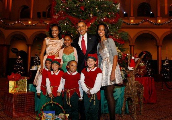 "President Obama, First Lady Michelle Obama and their daughters Malia (right) and Sasha pose with Christmas elves at the ""Christmas in Washington"" concert in Washington."