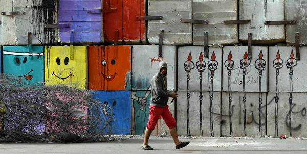 Graffiti is seen on a wall near the presidential palace in Cairo, where tens of thousands of Egyptians have marched in opposition to President Mohamed Morsi.