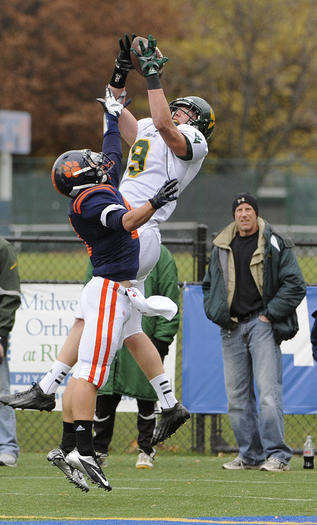 Waubonsie Valley's Troy Fumagalli tries to make a catch as Oak Park's Tom Odell defends.