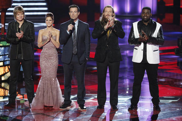 "Terry McDermott, left, Cassadee Pope, Carson Daly, Nicholas David and Trevin Hunte on ""The Voice."""