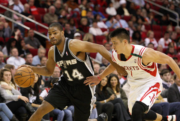 San Antonio Spurs point guard Gary Neal (14) attempts to drive the ball past Houston Rockets point guard Jeremy Lin (7) during the third quarter at Toyota Center.