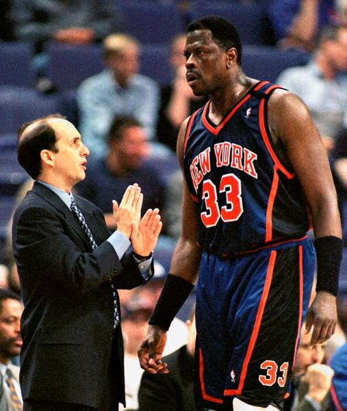 Former New York Knicks coach Jeff Van Gundy talks with Patrick Ewing during a game in 1999.