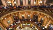The view of protestors filling the State Capital atrium in Lansing, Mich.