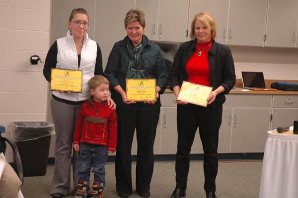 "Maureen Hollocker, director of the Great Start Collaborative of Charlevoix, Emmet and Northern Antrim counties, presented a ""Strengthening Families"" award to Harbor Springs parent Claire Swadling (from left), her son, Hayden, Shay Elementary counselor Joanie St. John and Harbor school district chief financial officer Pam Gibson, for working out a solution to get Hayden to preschool."