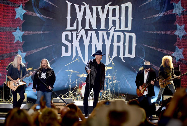 Rickey Medlocke and Johnny Van Zant of Lynyrd Skynyrd, singer and co-host Trace Adkins and Gary Rossington of Lynyrd Skynyrd perform onstage during the 2012 American Country Awards in Las Vegas, Nev.