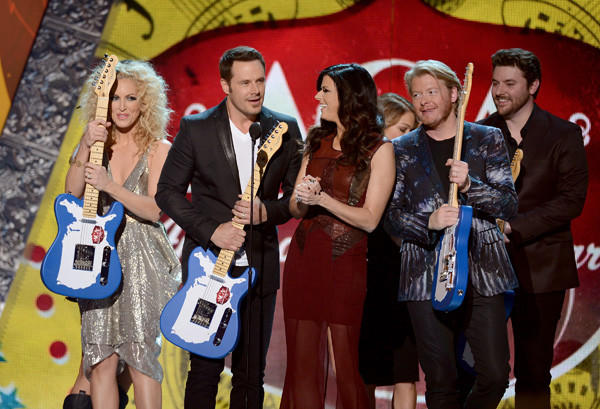 From left to right: Musicians Kimberly Roads Schlapman, Jimi Westbrook, Karen Fairchild and Phillip Sweet of Little Big Town accept the award for Music Video of the Year: Group from presenters LeAnn Rimes and Chris Young onstage during the 2012 American Country Awards in Las Vegas, Nev.