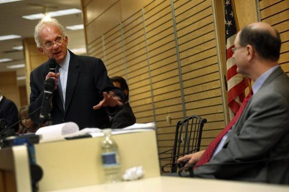 Reps. Howard Berman, left, and Brad Sherman at a candidates forum early this year.