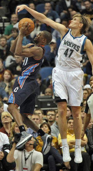 Minnesota's Andrei Kirilenko blocks a shot by Cory Higgins.
