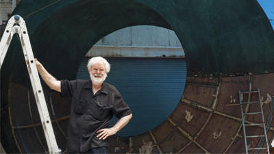 Helaman Ferguson, of North Laurel, poses with his newest sculpture, Umbilic Torus.