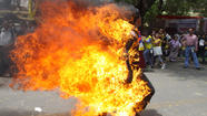 Tibetan youth sets himself afire