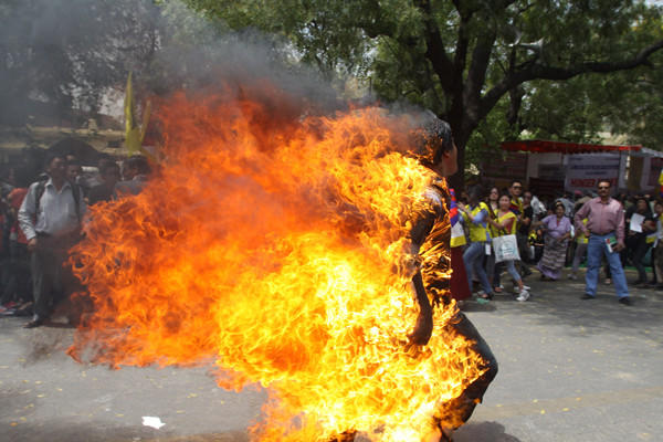 As part of a protest against Chinese President Hu Jintao's visit to the county, a Tibetan youth sets himself on fire in New Dehli in March.