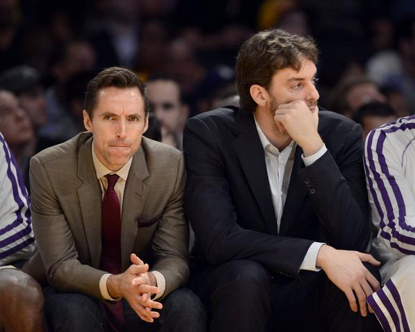 Injured Lakers Steve Nash, left, and Pau Gasol watch from the bench during the loss to Utah on Sunday.