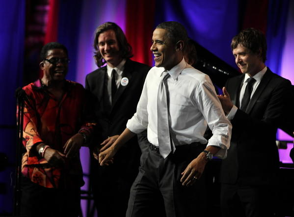 Jazz musician Herbie Hancock, left, and members of OK-Go are onstage as President Barack Obama celebrates his 50th birthday during a fundraiser at the Aragon Ballroom in Chicago last year.