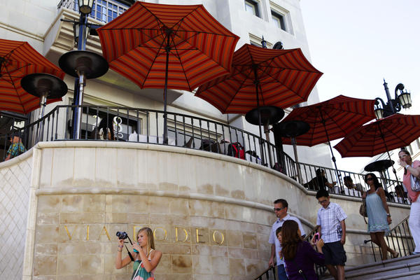 Consumer confidence in California fell slightly in the last three months of 2012 but remains near its highest level since the start of the recession, according to a Chapman University index. Above, shoppers visit Rodeo Drive in Beverly Hills..