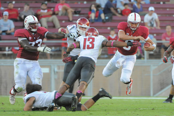 Stanford Cardinal quarterback Josh Nunes (6) is tackled by Washington State Cougars linebacker Darryl Monroe (13) during the third quarter at Stanford Stadium. The Cardinal defeated the Cougars 24-17.