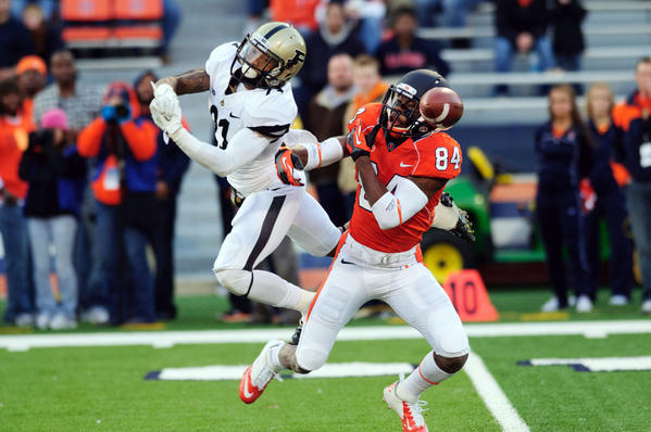 Purdue Boilermakers cornerback Ricardo Allen (21) breaks up a pass intended for Illinois Fighting Illini wide receiver Justin Hardee (84) during the second quarter at Memorial Stadium.