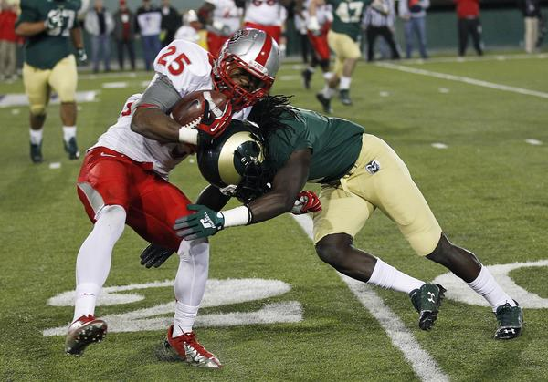 New Mexico Lobos running back Chase Clayton (25) is tackled by Colorado State Rams cornerback Shaq Bell (3) during the fourth quarter at Hughes Stadium.  The Rams beat the Lobos 24-20.