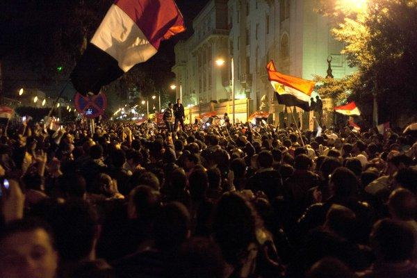 Protesters opposing Egyptian President Mohamed Morsi wave national flags and chant slogans during a demonstration in front of the presidential palace in Cairo.