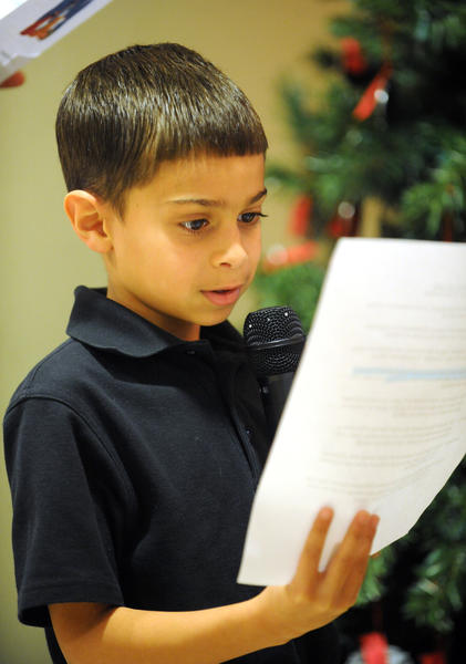 Sacred Heart Elementary 3rd grader Brian Lopez reads a prayer to his classmates. Sacred Heart Hospital held their Tree of Life Celebration Tuesday afternoon in the lobby of the hospital. Each ornament on the trees they lit had a name attached and were bought in memory of people no longer with us. Students from Sacred Heart Elementary School attended and participated in the event.