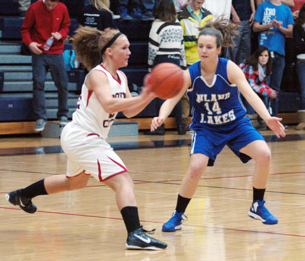 Inland Lakes senior Sarah Kolb (right) guards Boyne City senior Halee Boughton as Boughton makes a pass during Monday's non-league contest at the Boyne City High School gym. The Bulldogs defeated the Ramblers, 38-34, to move to 3-0 on the season.