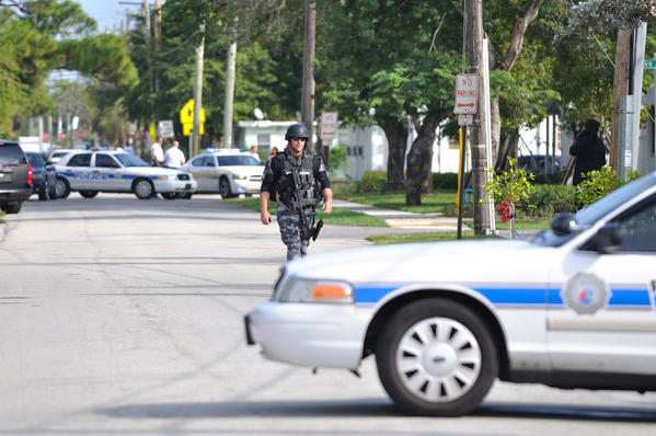Members of the Fort Lauderdale Police SWAT team respond after a chain-snatching suspect breaks into an abandoned home.