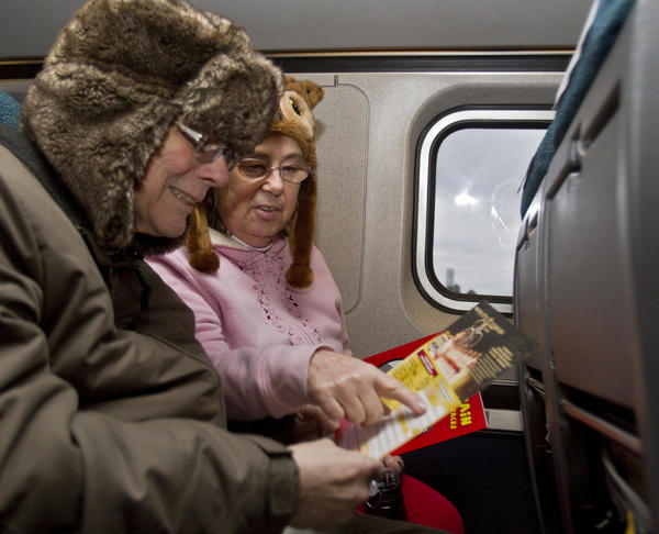 Everett and Virginia Laney examine a menu during a tour of a train car at the Norfolk Amtrak stop on Tuesday. The pair, who is from Long Island, says the new rail service will make it much easier to travel north to visit relatives. Norfolk's new Amtrak service opens to the public on Wednesday morning.
