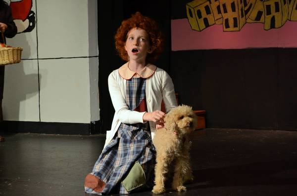 "Samantha Yakaitis, as Annie, sings to Sandy, a canine actor whose actual name is Graham, in Laurel Mill Playhouse's current production of ""Annie."""