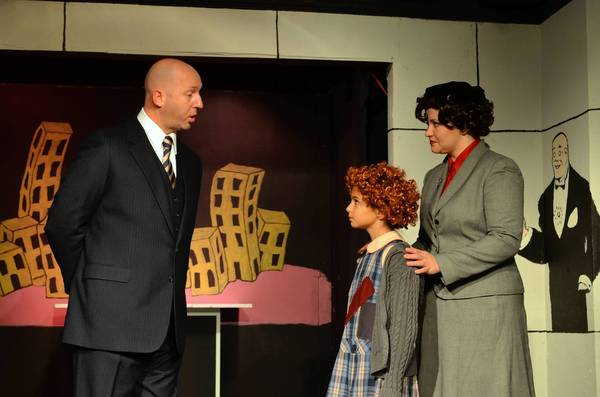 "Patrick Pase (Warbucks), Julia Laje (Annie) and  Emma Jensen (Grace Farrell) in the double-cast production of ""Annie,"" running through Dec. 22 at Laurel Mill Playhouse."