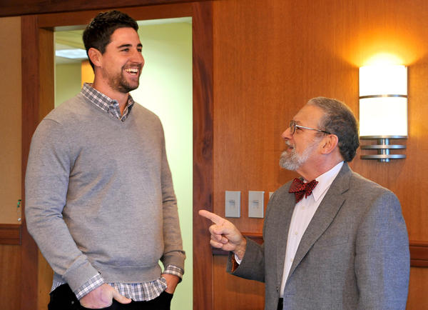 Ravens tight end Dennis Pitta meets University of Baltimore professor Dennis Pitta on Tuesday for the first time.