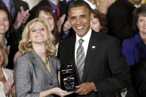 President Barack Obama presents the 2012 National Teacher of the Year award to Rebecca Mieliwocki, who teaches at Luther Burbank Middle School, on Tuesday, April 24, 2012, during a ceremony in the East Room at the White House in Washington.