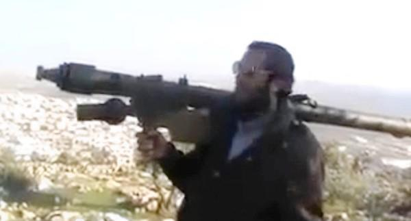 Rebel Abu Omeir, seen in a video posted on YouTube, brandishes an SA-16 missile launcher in Syria's Aleppo province.