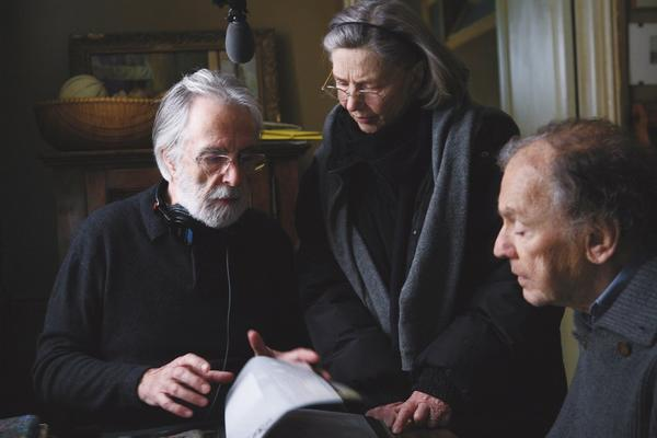 "Director Michael Haneke, left, Emmanuelle Riva and Jean-Louis Trintignant discuss a scene while shooting ""Amour."""