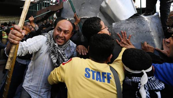 Protesters dismantle a barrier at the presidential palace in Cairo.